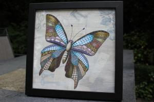 Zentangle butterfly, op gesso, handgetekend en met copic markers uitgewerkt. Ingelijst formaat 30x30cm. Prijs inclusief lijst: e 30
